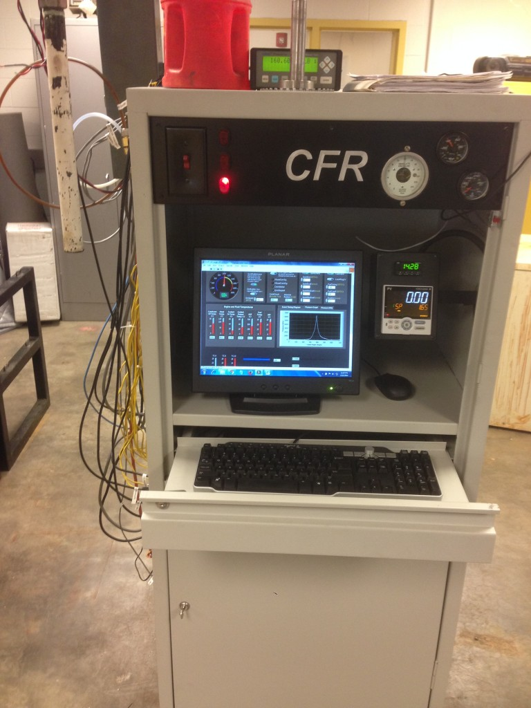 The CFR cabinet controls and records data from the research engine